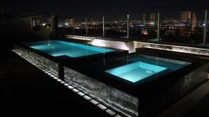 double pools glowing at night