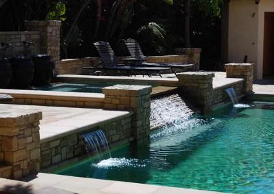 Pool and spa with cascade waterfalls
