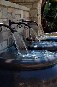 Detail of water feature above spa and pool