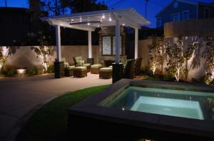 Kingstons outdoor living space: spa, outdoor living room, and fireplace