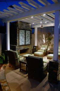Outdoor living room with fireplace and Pergola featuring outdoor television cabinet