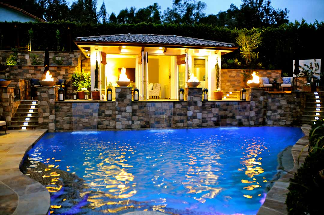 celebrity house pool fire bowls outdoor living room