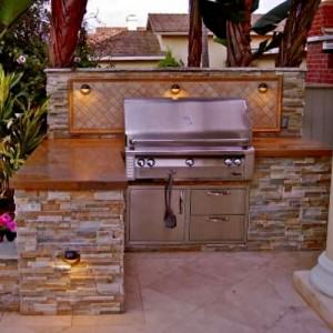 Stone wall with built in bbq grill