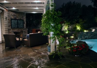 Outdoor living room next to pool