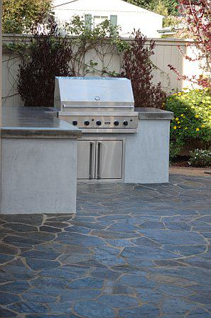 Outdoor kitchen with built in BBQ