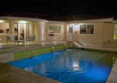 Nitz House - Marble travertine decking , glass tile, multi-colored lighting