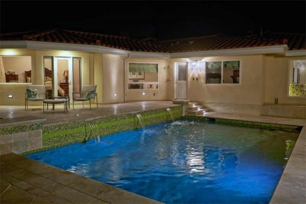 Nitz House – Marble travertine decking , glass tile, multi-colored lighting