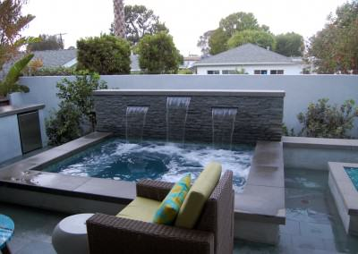 Orland Residence - Outdoor living room and spa with waterfall
