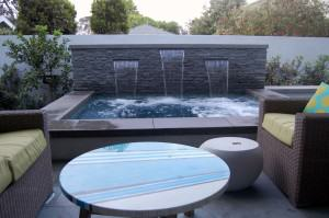 Orland Residence – Outdoor seating area and spa with waterfall
