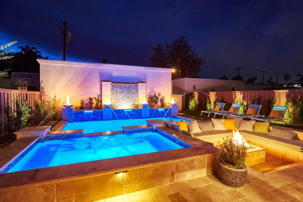 south redondo beach – pool, swim-up bar, hot tub, and fountain by Outdoor Hardscapes