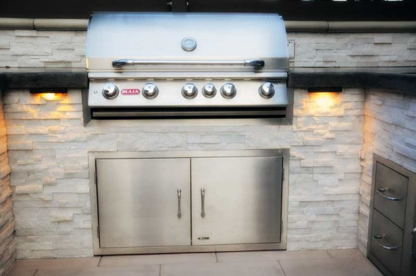Barbecue with access doors