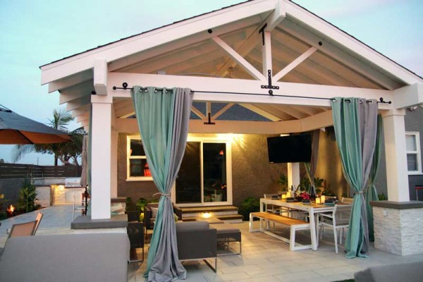 Outdoor living area with mounted television