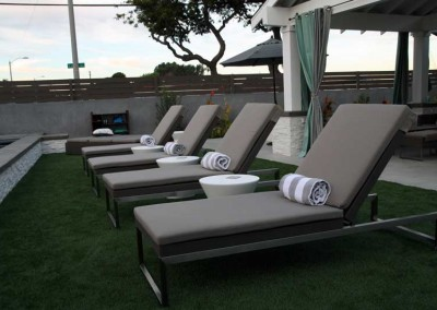 Why go on vacation when you can lounge in poolside luxury at home?