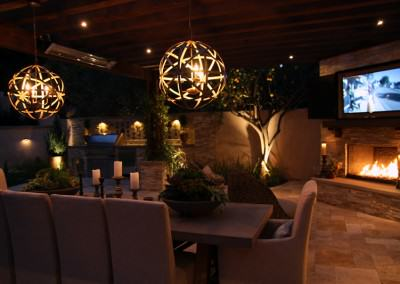 The Winns - Modern chandeliers illuminate the outdoor dining area