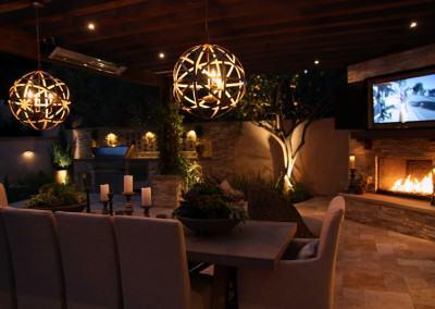 The Winns - Modern chandeliers illuminate the outdoor dining area