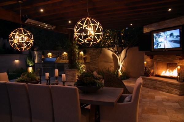 The Winns – Modern chandeliers illuminate the outdoor dining area